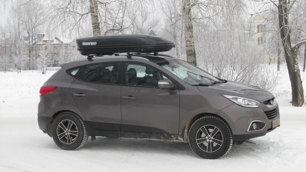 Hyundai IX35 с дополнительным багажником на крыше